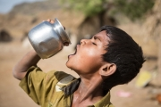 Child in India is drinking water